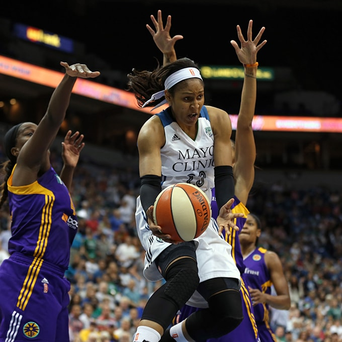 MINNEAPOLIS, MN - SEPTEMBER 22:  Maya Moore #23 of the Minnesota Lynx makes a pass against the Los Angeles Sparks during Game 3 of the 2015 WNBA Western Conference Semifinal on September 22, 2015 at Target Center in Minneapolis, Minnesota.  NOTE TO USER: User expressly acknowledges and agrees that, by downloading and or using this Photograph, user is consenting to the terms and conditions of the Getty Images License Agreement. Mandatory Copyright Notice: Copyright 2015 NBAE (Photo by Jordan Johnson/NBAE via Getty Images)