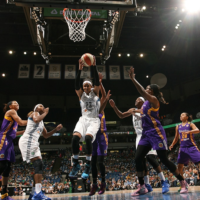 MINNEAPOLIS, MN - SEPTEMBER 22:  Maya Moore #23 of the Minnesota Lynx grabs the rebound against the Los Angeles Sparks during Game 3 of the 2015 WNBA Western Conference Semifinal on September 22, 2015 at Target Center in Minneapolis, Minnesota.  NOTE TO USER: User expressly acknowledges and agrees that, by downloading and or using this Photograph, user is consenting to the terms and conditions of the Getty Images License Agreement. Mandatory Copyright Notice: Copyright 2015 NBAE (Photo by David Sherman/NBAE via Getty Images)
