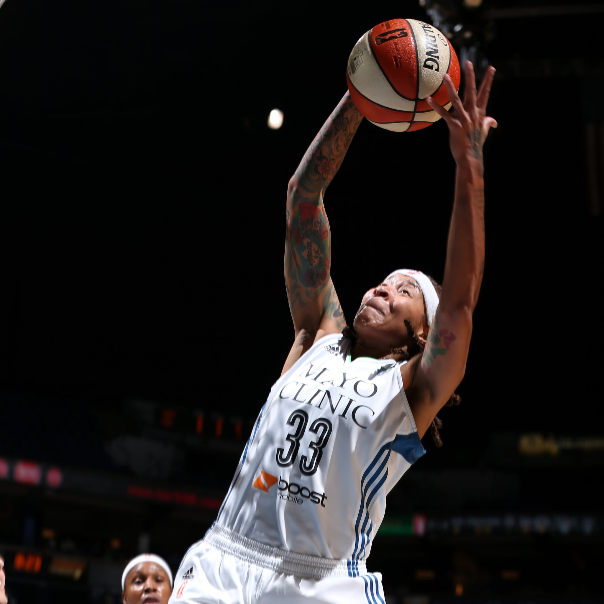 MINNEAPOLIS, MN - SEPTEMBER 18:  Seimone Augustus #33 of the Minnesota Lynx grabs the rebound against the Los Angeles Sparks during Game 1 of the 2015 WNBA Western Conference Semifinal on September 18, 2015 at Target Center in Minneapolis, Minnesota.  NOTE TO USER: User expressly acknowledges and agrees that, by downloading and or using this Photograph, user is consenting to the terms and conditions of the Getty Images License Agreement. Mandatory Copyright Notice: Copyright 2015 NBAE (Photo by David Sherman/NBAE via Getty Images)