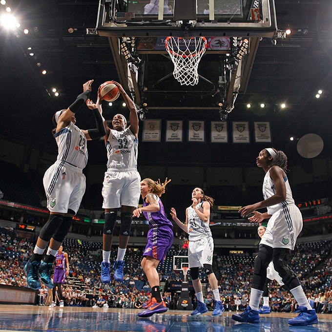 MINNEAPOLIS, MN - SEPTEMBER 24:  Rebekkah Brunson #32 of the Minnesota Lynx grabs a rebound against the Phoenix Mercury during Game One of the WNBA Western Conference Finals on September 24, 2015 at Target Center in Minneapolis, Minnesota.  NOTE TO USER: User expressly acknowledges and agrees that, by downloading and or using this Photograph, user is consenting to the terms and conditions of the Getty Images License Agreement. Mandatory Copyright Notice: Copyright 2015 NBAE (Photo by David Sherman/NBAE via Getty Images)