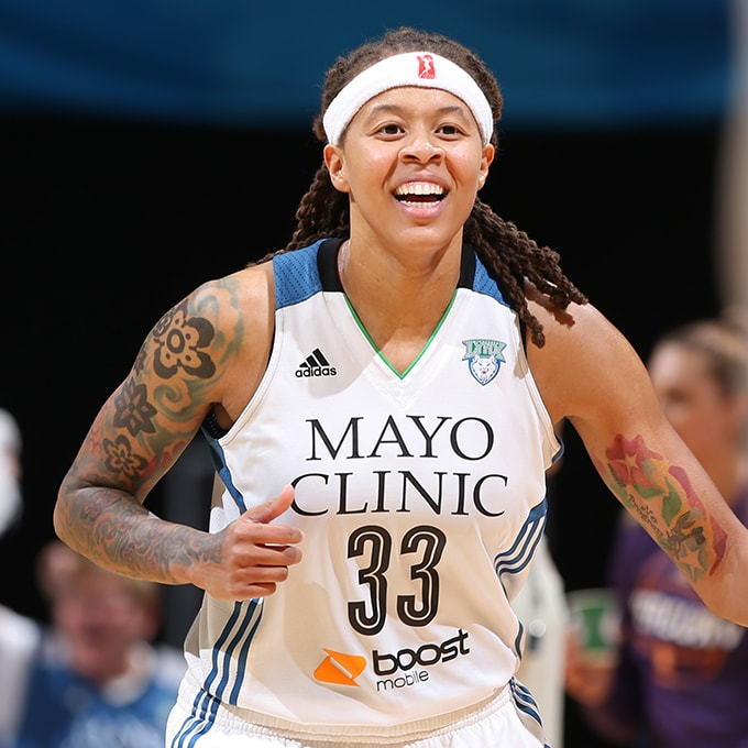 MINNEAPOLIS, MN - SEPTEMBER 24:  Seimone Augustus #33 of the Minnesota Lynx smiles and runs up court against the Phoenix Mercury during Game One of the WNBA Western Conference Finals on September 24, 2015 at Target Center in Minneapolis, Minnesota.  NOTE TO USER: User expressly acknowledges and agrees that, by downloading and or using this Photograph, user is consenting to the terms and conditions of the Getty Images License Agreement. Mandatory Copyright Notice: Copyright 2015 NBAE (Photo by David Sherman/NBAE via Getty Images)