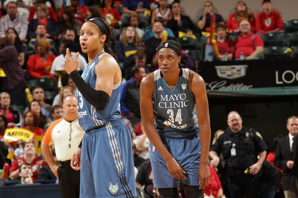 Maya Moore #23 of the Minnesota Lynx and Sylvia Fowles #34 of the Minnesota Lynx talk during Game Three of the 2015 WNBA Finals