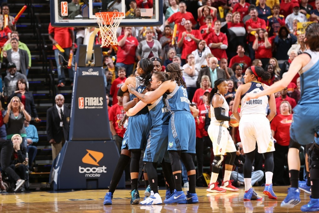 Maya Moore #23 of the Minnesota Lynx celebrates with her teammates after hitting the game winning shot during Game Three