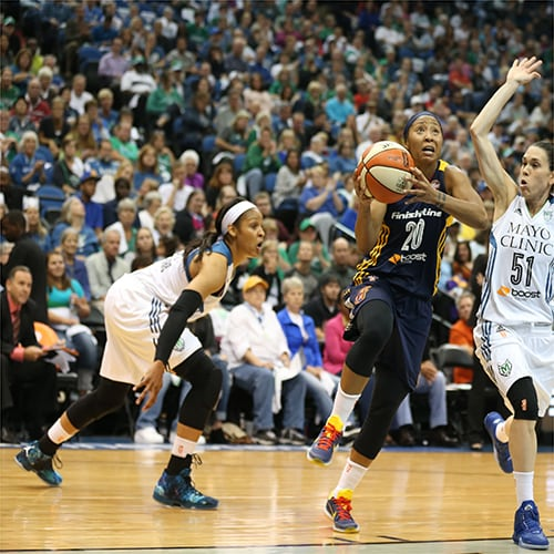 MINNEAPOLIS, MN - OCTOBER 6:  Briann January #20 of the Indiana Fever drives to the basket against Anna Cruz #51 of the Minnesota Lynx during Game Two of the 2015 WNBA Finals on October 6, 2015 at Target Center in Minneapolis, Minnesota.  NOTE TO USER: User expressly acknowledges and agrees that, by downloading and or using this Photograph, user is consenting to the terms and conditions of the Getty Images License Agreement. Mandatory Copyright Notice: Copyright 2015 NBAE (Photo by Jordan Johnson/NBAE via Getty Images)