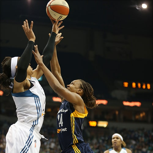 MINNEAPOLIS, MN - OCTOBER 6:  Tamika Catchings #24 of the Indiana Fever shoots the ball against the Minnesota Lynx during Game Two of the 2015 WNBA Finals on October 6, 2015 at Target Center in Minneapolis, Minnesota.  NOTE TO USER: User expressly acknowledges and agrees that, by downloading and or using this Photograph, user is consenting to the terms and conditions of the Getty Images License Agreement. Mandatory Copyright Notice: Copyright 2015 NBAE (Photo by Jordan Johnson/NBAE via Getty Images)