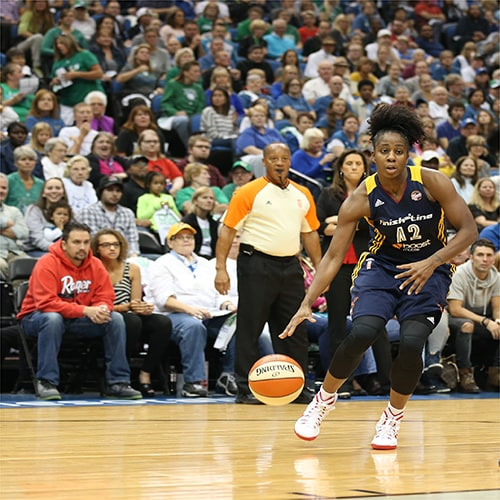 MINNEAPOLIS, MN - OCTOBER 6:  Shenise Johnson #42 of the Indiana Fever handles the ball against the Minnesota Lynx during Game Two of the 2015 WNBA Finals on October 6, 2015 at Target Center in Minneapolis, Minnesota.  NOTE TO USER: User expressly acknowledges and agrees that, by downloading and or using this Photograph, user is consenting to the terms and conditions of the Getty Images License Agreement. Mandatory Copyright Notice: Copyright 2015 NBAE (Photo by Jordan Johnson/NBAE via Getty Images)