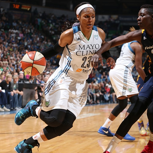 MINNEAPOLIS, MN - OCTOBER 6:  Maya Moore #23 of the Minnesota Lynx handles the ball against the Indiana Fever during Game Two of the 2015 WNBA Finals on October 6, 2015 at Target Center in Minneapolis, Minnesota.  NOTE TO USER: User expressly acknowledges and agrees that, by downloading and or using this Photograph, user is consenting to the terms and conditions of the Getty Images License Agreement. Mandatory Copyright Notice: Copyright 2015 NBAE (Photo by David Sherman/NBAE via Getty Images)