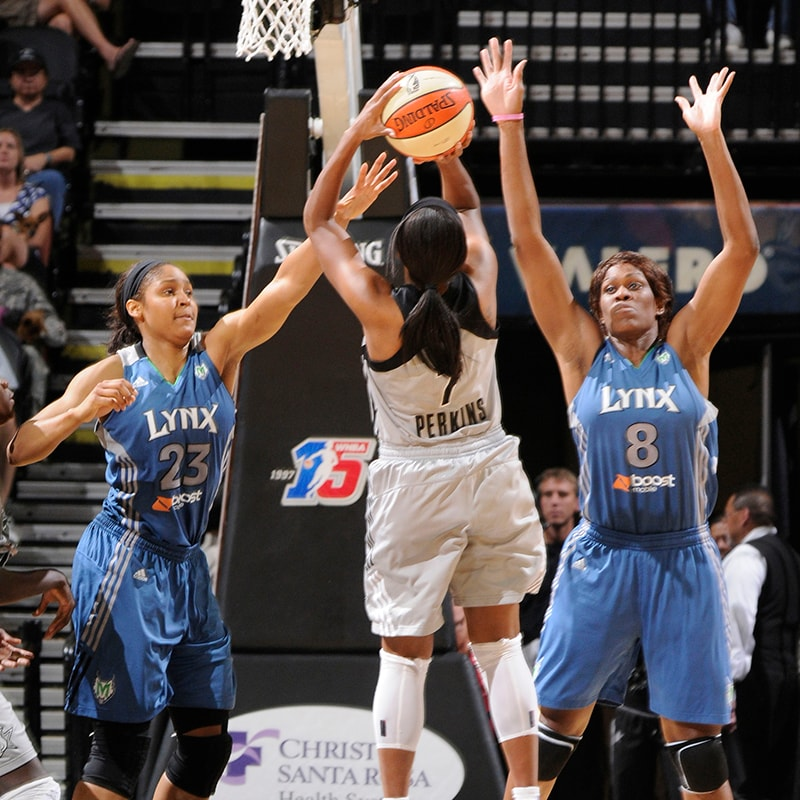 SAN ANTONIO, TX - AUGUST 28: Jia Perkins #7 of the San Antonio Silver Stars shoots against Maya Moore #23 and Taj McWilliams-Franklin #8 of the Minnesota Lynx at the AT&T Center on August 28, 2011 in San Antonio, Texas. NOTE TO USER: User expressly acknowledges and agrees that, by downloading and or using this photograph, user is consenting to the terms and conditions of the Getty Images License Agreement. Mandatory Copyright Notice: Copyright 2011 NBAE (Photos by D. Clarke Evans/NBAE via Getty Images)