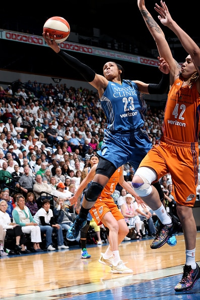 MINNEAPOLIS, MN - MAY 14: Maya Moore #23 of the Minnesota Lynx goes for the lay up during the game against the Phoenix Mercury during the WNBA game on May 14, 2016 at Target Center in Minneapolis, Minnesota. NOTE TO USER: User expressly acknowledges and agrees that, by downloading and or using this Photograph, user is consenting to the terms and conditions of the Getty Images License Agreement. Mandatory Copyright Notice: Copyright 2016 NBAE (Photo by David Sherman/NBAE via Getty Images)