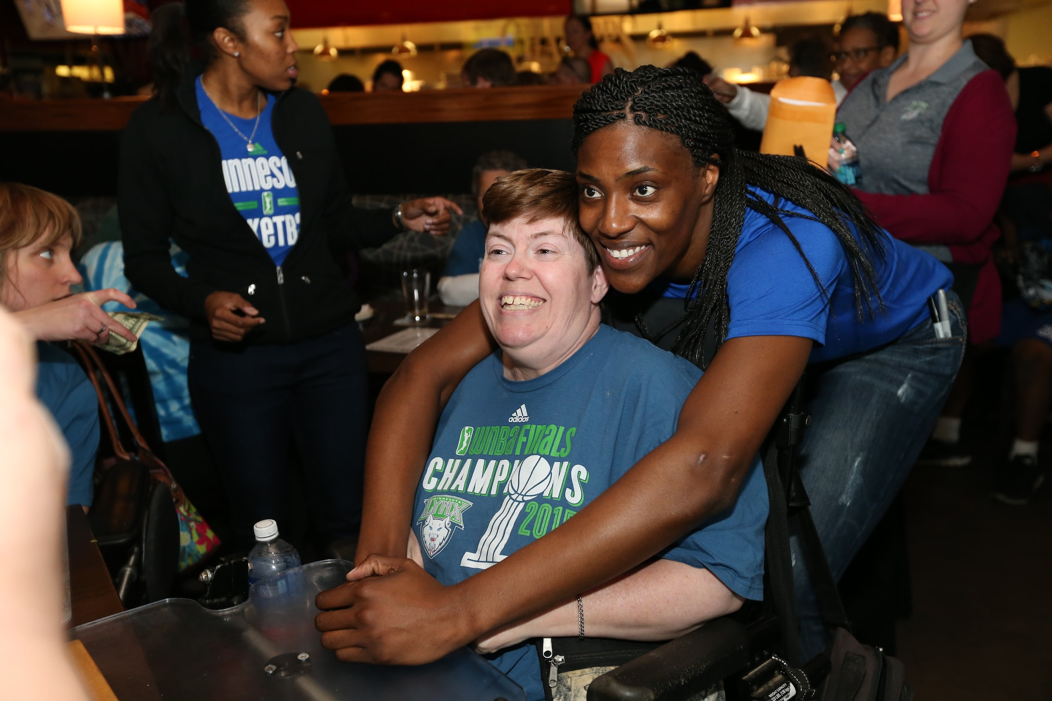 MINNEAPOLIS, MN - MAY 3: Minnesota Lynx players and coaches wait on fansÕ tables, pour drinks, sign autographs and pose for photographs to raise money for the Lynx FastBreak Foundation, which provides and supports hands-on programs for Minnesota youth on May 3, 2016 at Champps Minnetonka restaurant in Minnetonka, Minnesota. NOTE TO USER: User expressly acknowledges and agrees that, by downloading and or using this Photograph, user is consenting to the terms and conditions of the Getty Images License Agreement. Mandatory Copyright Notice: Copyright 2016 NBAE (Photo by David Sherman/NBAE via Getty Images)
