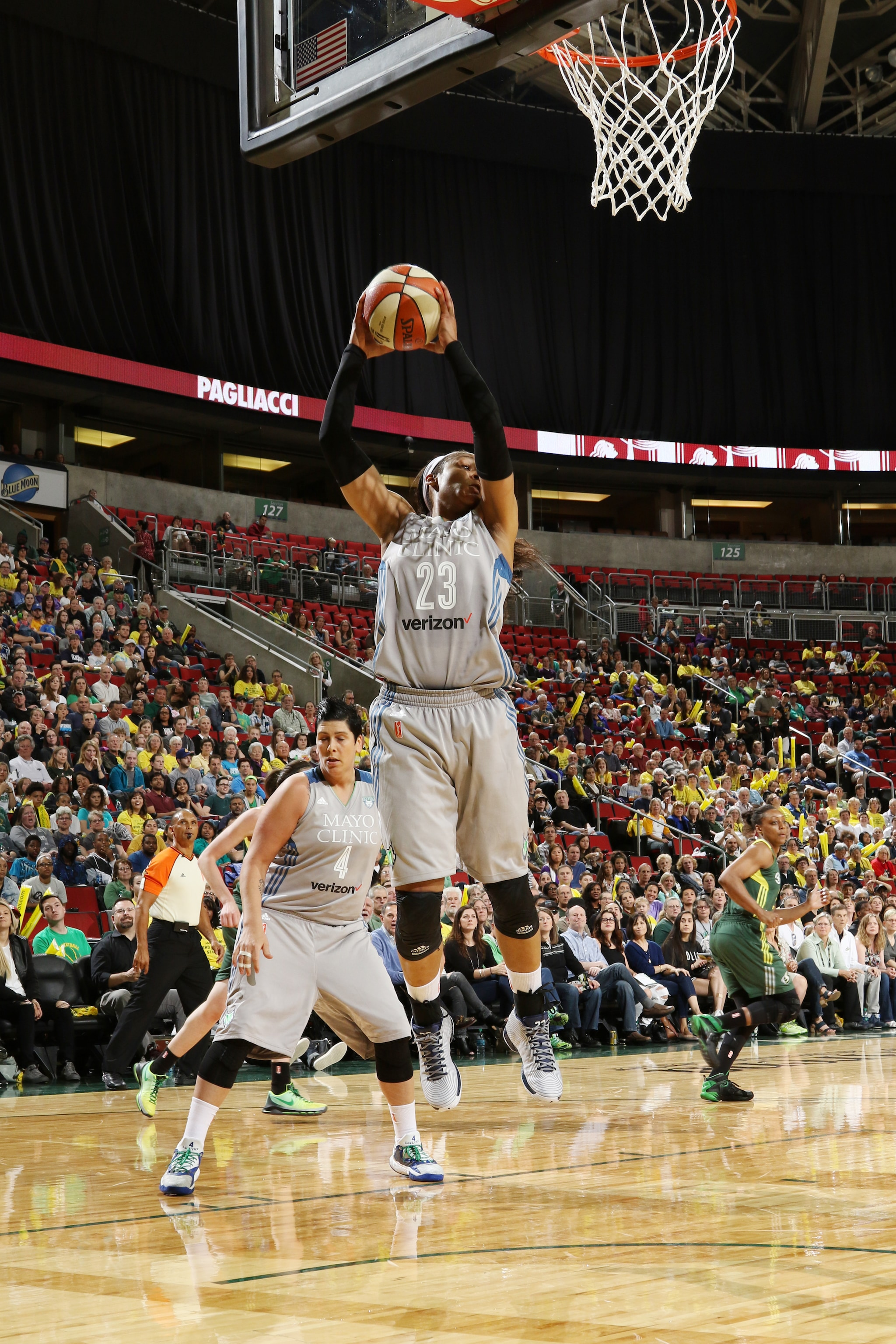 SEATTLE, WA - MAY 22:  Maya Moore #23 of the Minnesota Lynx grabs the rebound against the Seattle Storm on May 22, 2016 at KeyArena in Seattle, Washington. NOTE TO USER: User expressly acknowledges and agrees that, by downloading and or using this photograph, user is consenting to the terms and conditions of Getty Images License Agreement. Mandatory Copyright Notice: Copyright 2016 NBAE (Photo by Josh Huston/NBAE via Getty Images)