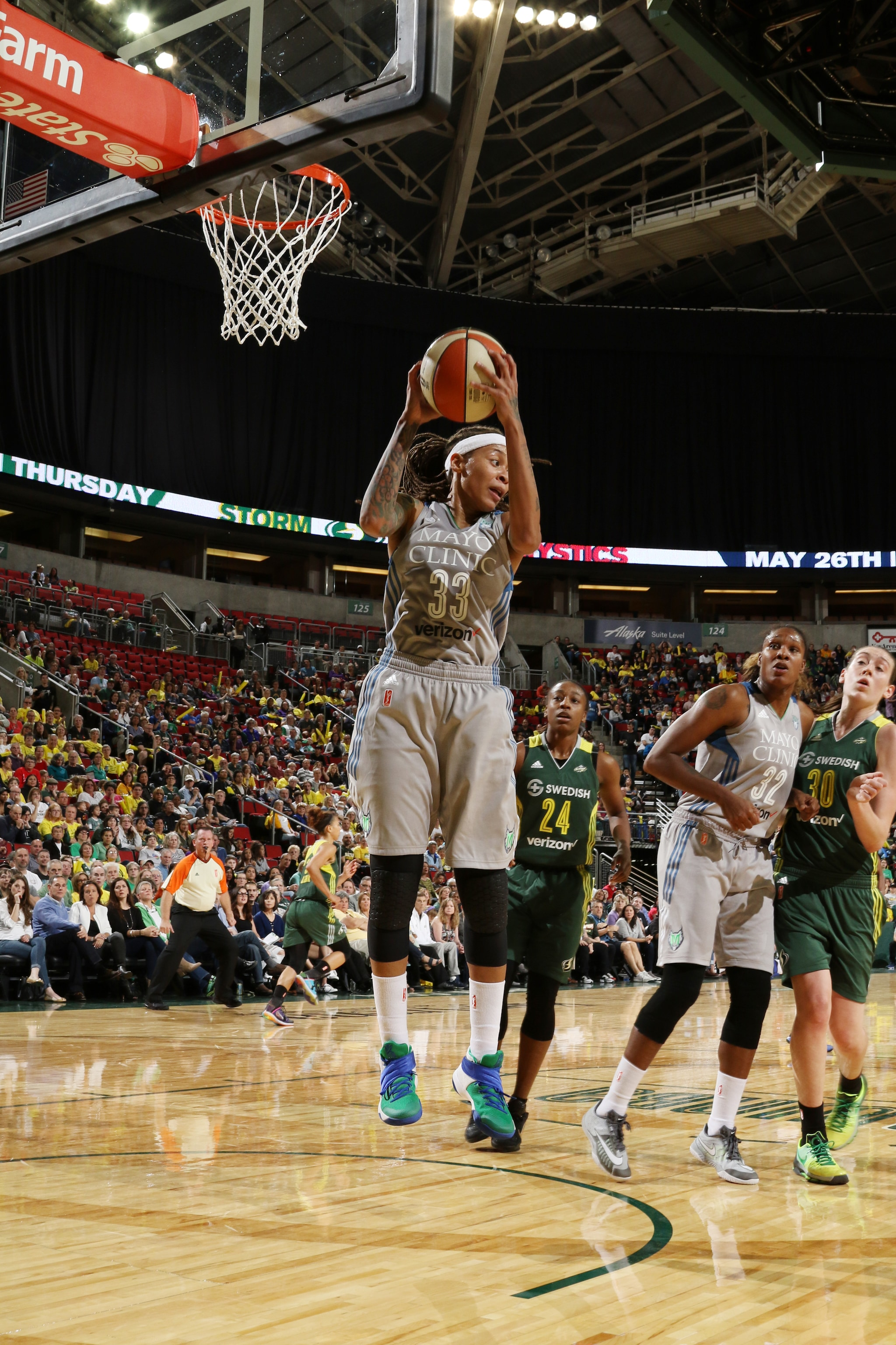 SEATTLE, WA - MAY 22:  Seimone Augustus #33 of the Minnesota Lynx grabs the rebound against the Seattle Storm on May 22, 2016 at KeyArena in Seattle, Washington. NOTE TO USER: User expressly acknowledges and agrees that, by downloading and or using this photograph, user is consenting to the terms and conditions of Getty Images License Agreement. Mandatory Copyright Notice: Copyright 2016 NBAE (Photo by Josh Huston/NBAE via Getty Images)