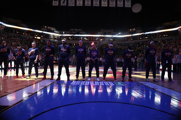 MINNEAPOLIS, MN - MAY 27:  The Indiana Fever stand for the National Anthem before the game against the Minnesota Lynx on May 27, 2016 at Target Center in Minneapolis, Minnesota. NOTE TO USER: User expressly acknowledges and agrees that, by downloading and or using this Photograph, user is consenting to the terms and conditions of the Getty Images License Agreement. Mandatory Copyright Notice: Copyright 2016 NBAE (Photo by Jordan Johnson/NBAE via Getty Images)