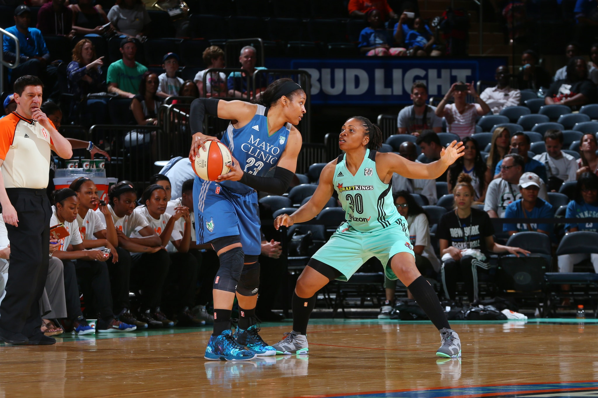 NEW YORK, NY - MAY 31: Maya Moore #23 of the Minnesota Lynx defends the ball against Tanisha Wright #30 of the New York Liberty during the game on May 31, 2016 at Madison Square Garden in New York, New York. NOTE TO USER: User expressly acknowledges and agrees that, by downloading and or using this Photograph, user is consenting to the terms and conditions of the Getty Images License Agreement. Mandatory Copyright Notice: Copyright 2016 NBAE (Photo by Mike Stobe/NBAE via Getty Images)