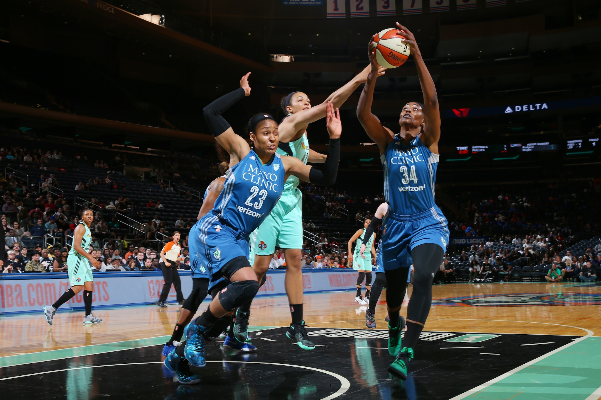 NEW YORK, NY - MAY 31: Sylvia Fowles #34 of the Minnesota Lynx grabs the rebound against the New York Liberty during the game on May 31, 2016 at Madison Square Garden in New York, New York. NOTE TO USER: User expressly acknowledges and agrees that, by downloading and or using this Photograph, user is consenting to the terms and conditions of the Getty Images License Agreement. Mandatory Copyright Notice: Copyright 2016 NBAE (Photo by Mike Stobe/NBAE via Getty Images)