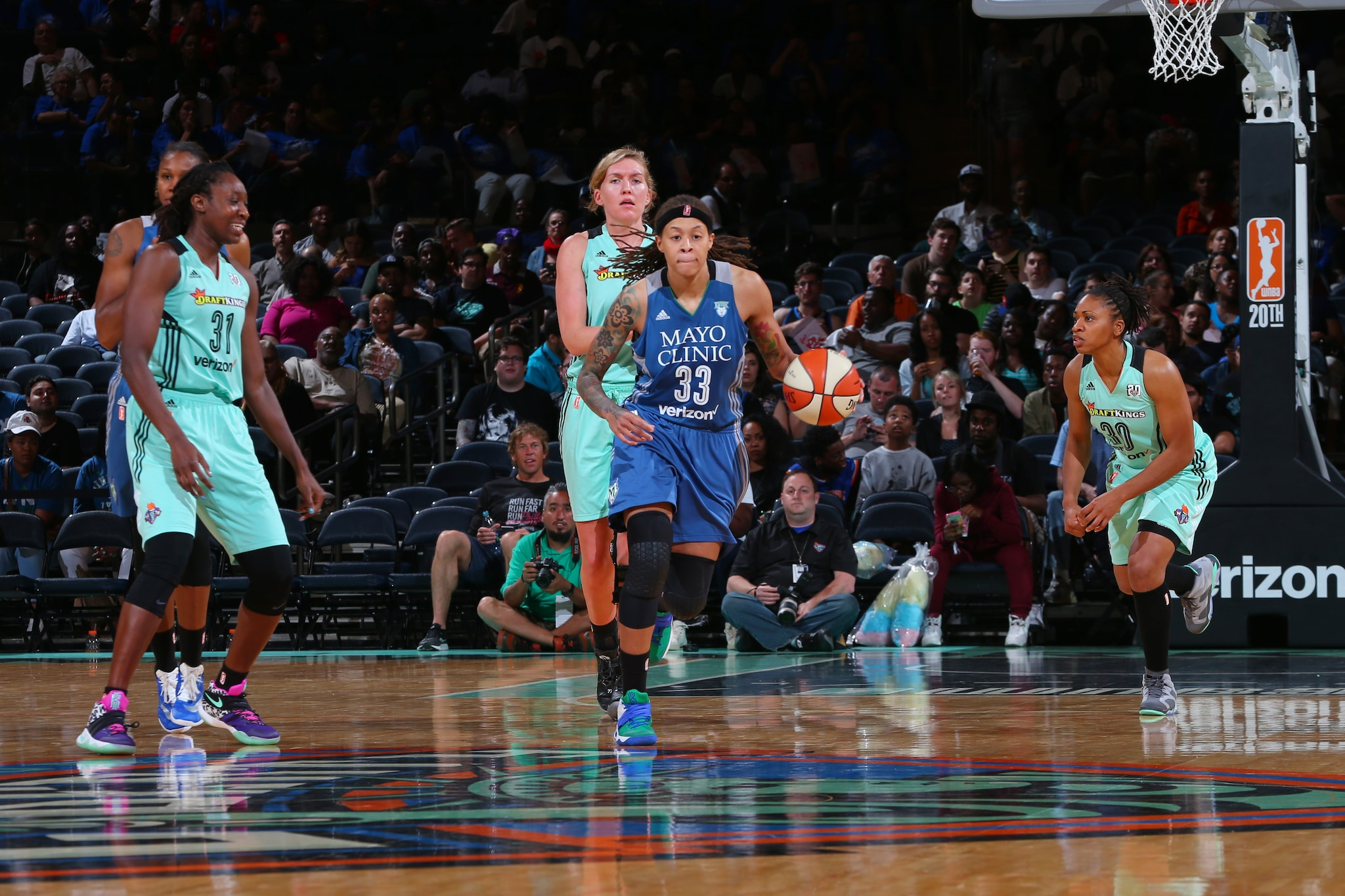 NEW YORK, NY - MAY 31: Seimone Augustus #33 of the Minnesota Lynx drives to the basket against the New York Liberty during the game on May 31, 2016 at Madison Square Garden in New York, New York. NOTE TO USER: User expressly acknowledges and agrees that, by downloading and or using this Photograph, user is consenting to the terms and conditions of the Getty Images License Agreement. Mandatory Copyright Notice: Copyright 2016 NBAE (Photo by Mike Stobe/NBAE via Getty Images)