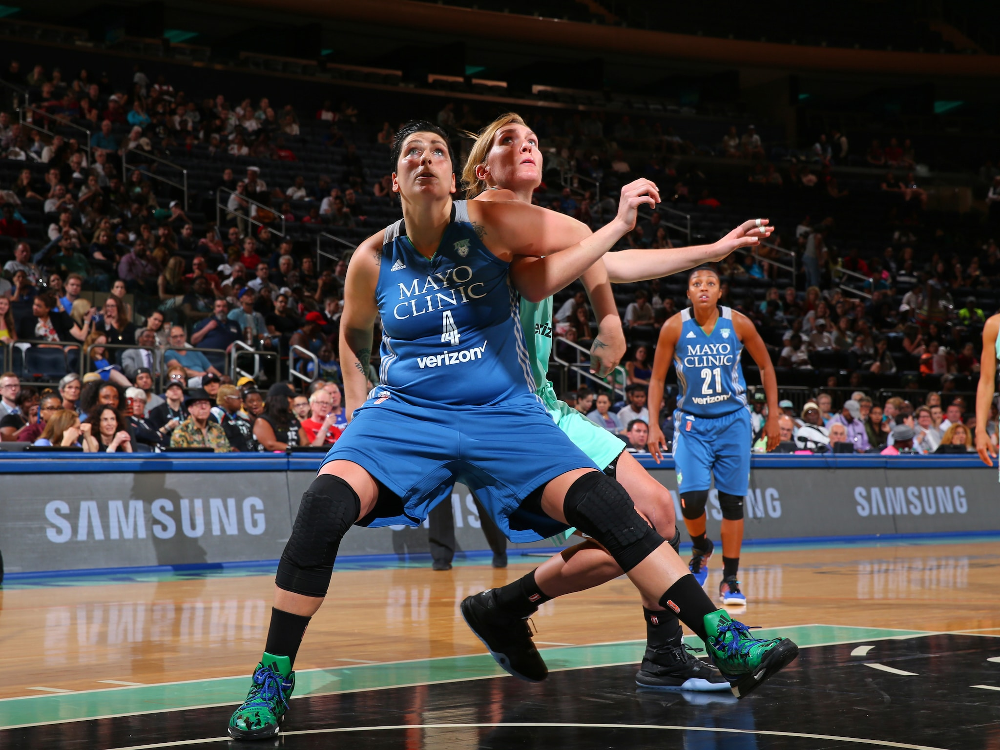 NEW YORK, NY - MAY 31:  Janel McCarville #4 of the Minnesota Lynx fights for position against Carolyn Swords #8 of the New York Liberty during the game on May 31, 2016 at Madison Square Garden in New York, New York. NOTE TO USER: User expressly acknowledges and agrees that, by downloading and or using this Photograph, user is consenting to the terms and conditions of the Getty Images License Agreement. Mandatory Copyright Notice: Copyright 2016 NBAE (Photo by Mike Stobe/NBAE via Getty Images)