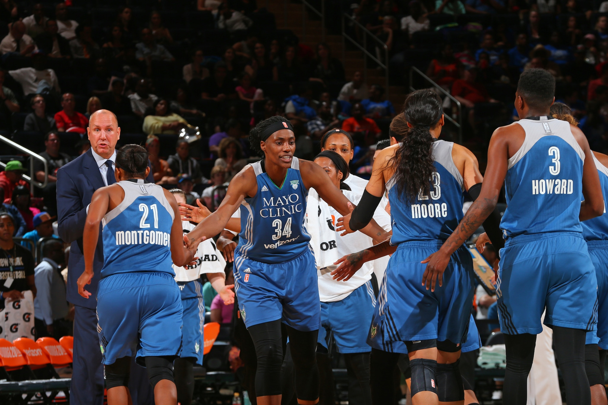 NEW YORK, NY - MAY 31:  Sylvia Fowles #34 of the Minnesota Lynx high fives her teammate during the game against the New York Liberty during the game on May 31, 2016 at Madison Square Garden in New York, New York. NOTE TO USER: User expressly acknowledges and agrees that, by downloading and or using this Photograph, user is consenting to the terms and conditions of the Getty Images License Agreement. Mandatory Copyright Notice: Copyright 2016 NBAE (Photo by Mike Stobe/NBAE via Getty Images)