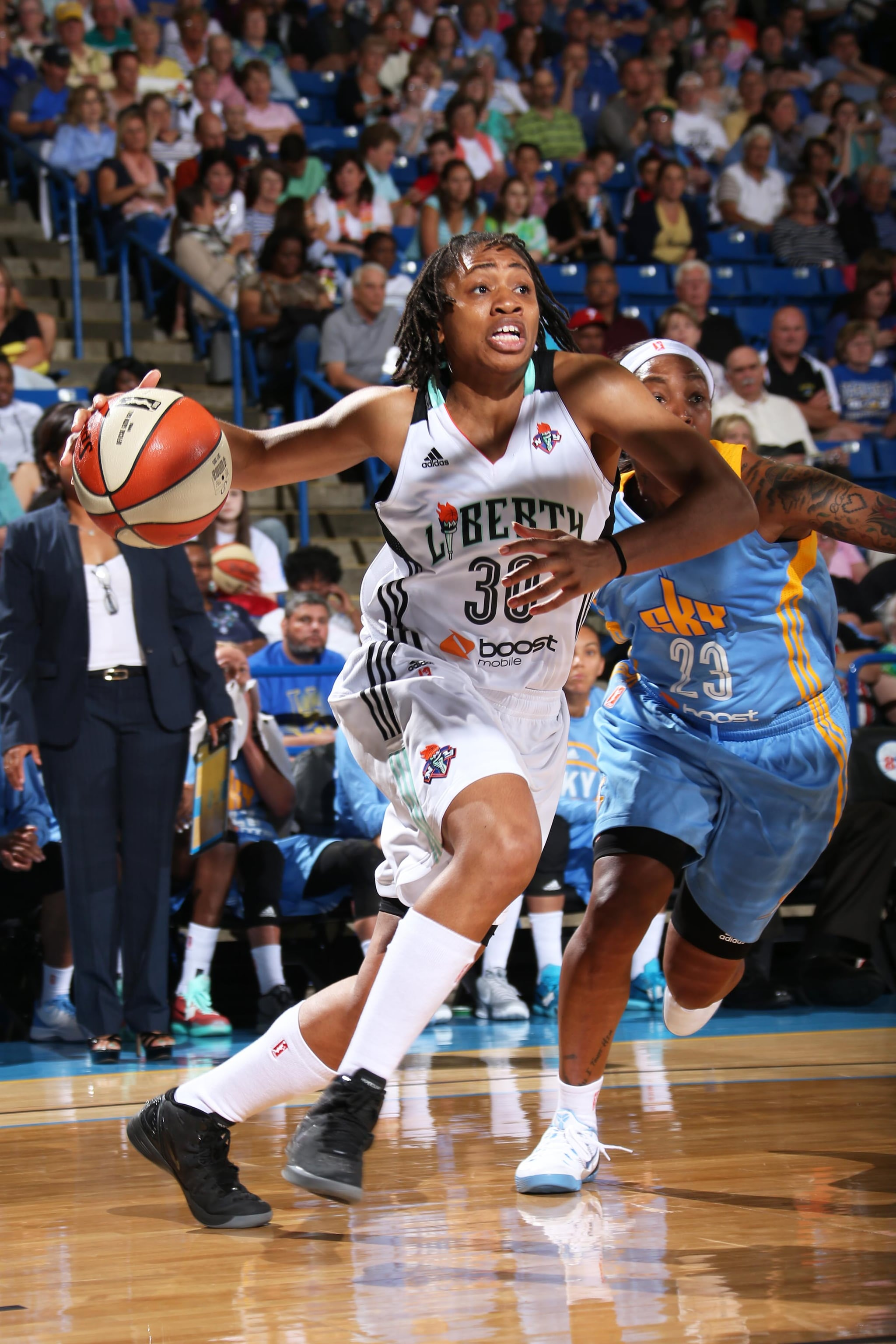 Tanisha Wright #30 of the New York Liberty handles the ball against the Chicago Sky at the Bob Carpenter Center in Newark, DE on May 22, 2015.