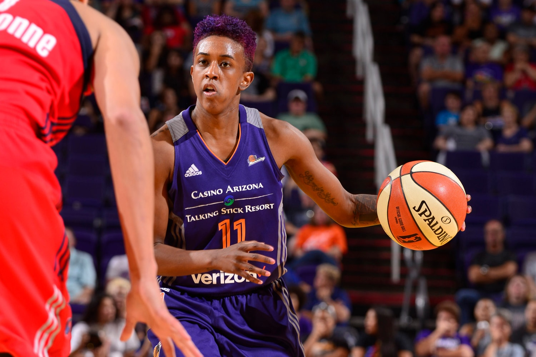 Danielle Robinson dribbles the ball