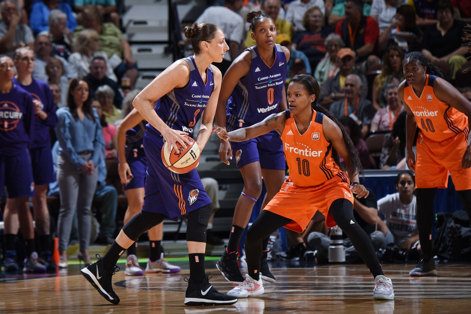 Diana Taurasi makes a play during Phoenix Mercury v Connecticut Sun