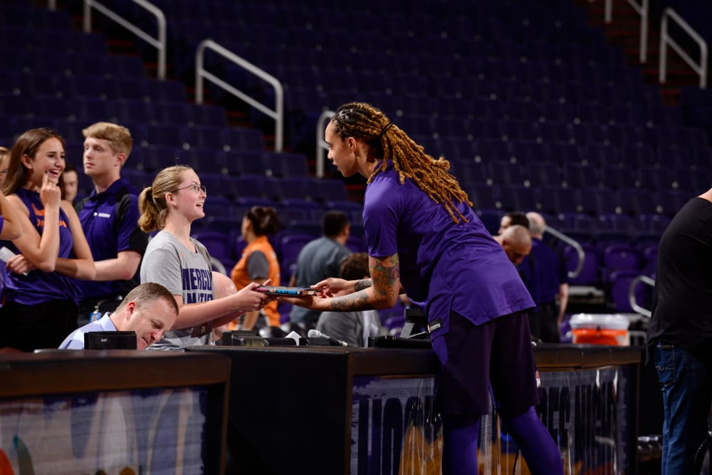 Brittney Griner with a Mercury young fan