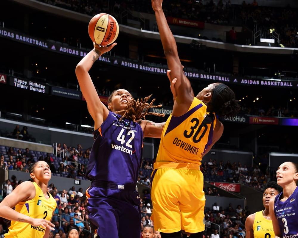 Brittney Griner shoots over a defender