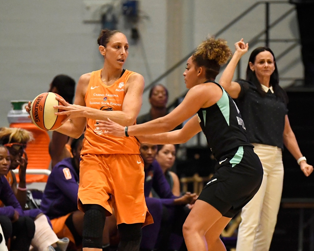 Diana Taurasi looks to pas