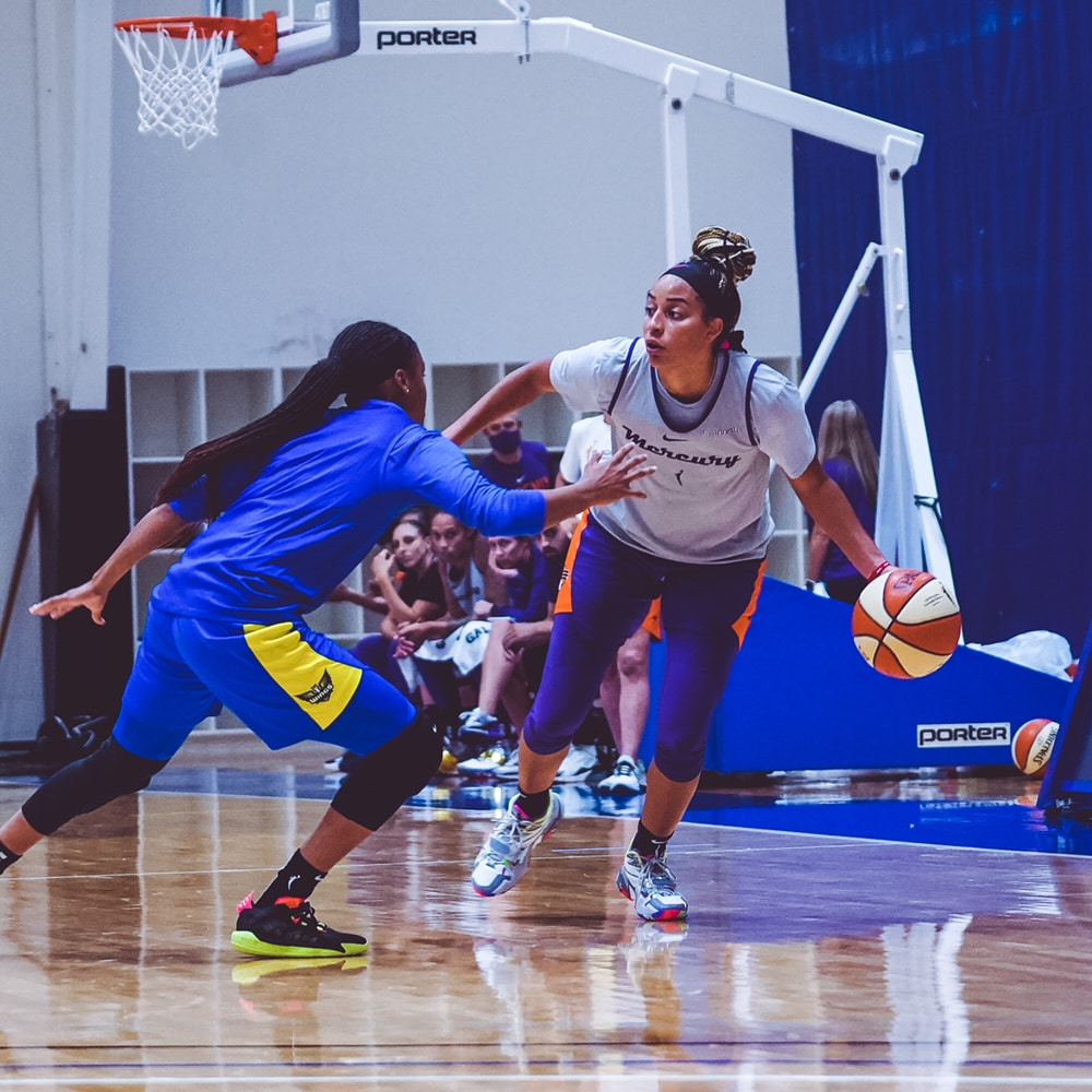 Bria Hartley dribbles up court