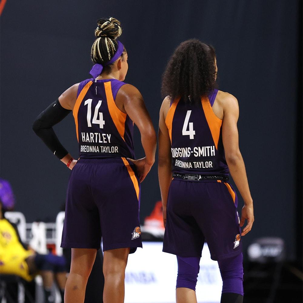 Bria Hartley and Skylar-Diggins Smith look on