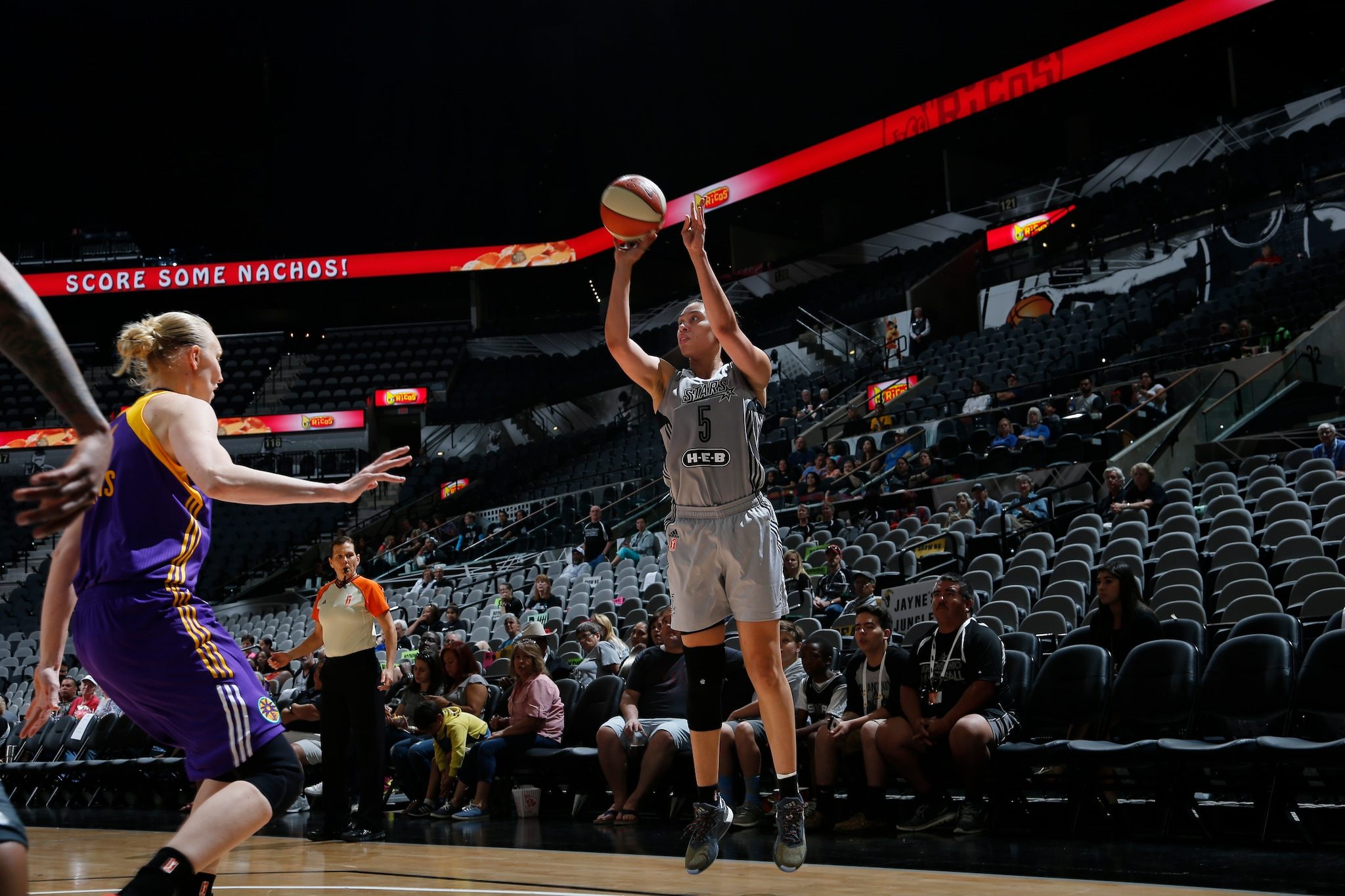 SAN ANTONIO, TX - MAY 9: Dearica Hamby #5 of the San Antonio Stars shoots the ball against the Los Angeles Sparks on May 9, 2016 at the AT&T Center in San Antonio, Texas. NOTE TO USER: User expressly acknowledges and agrees that, by downloading and or using this photograph, user is consenting to the terms and conditions of the Getty Images License Agreement. Mandatory Copyright Notice: Copyright 2016 NBAE (Photos by Chris Covatta/NBAE via Getty Images)