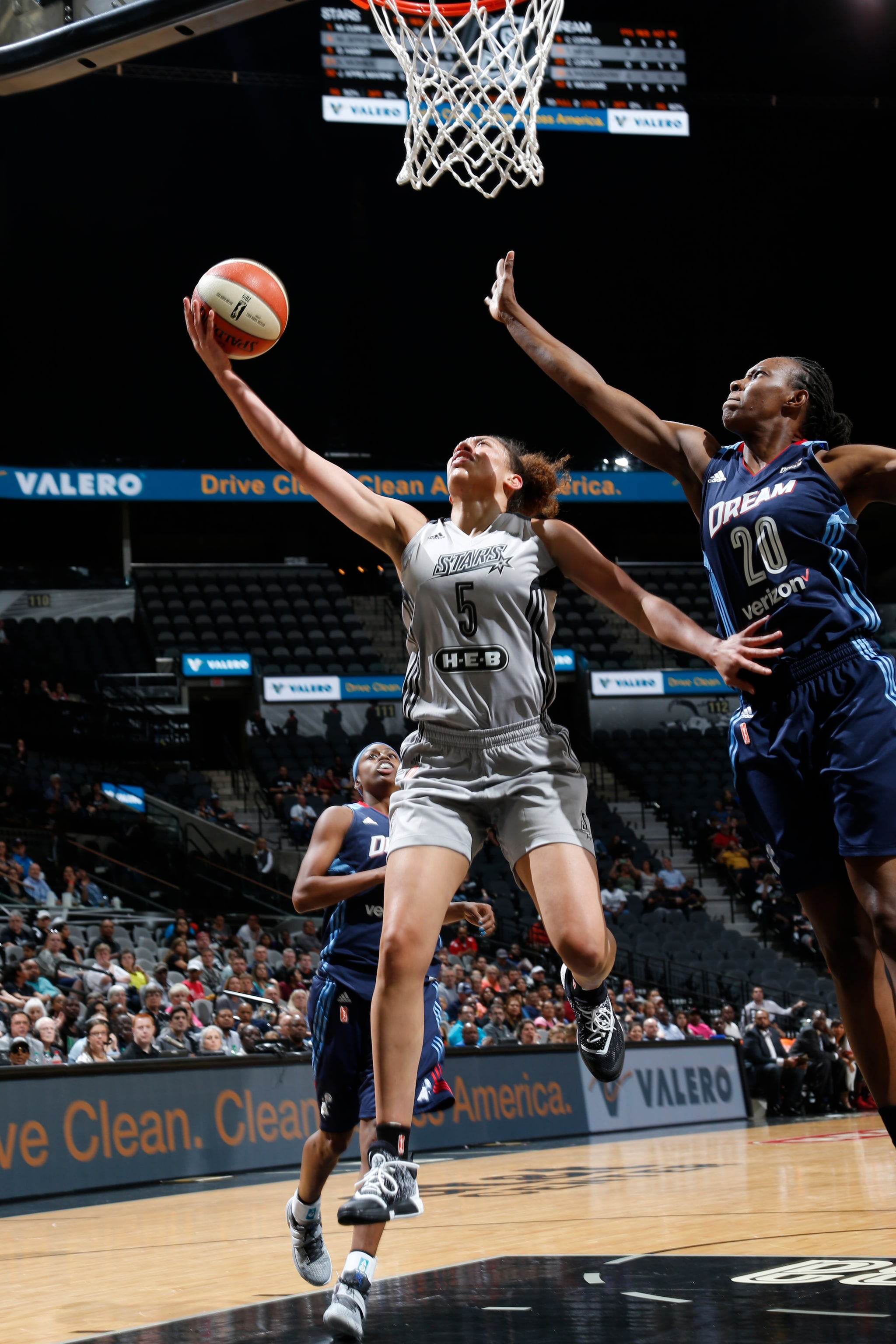 SAN ANTONIO, TX - MAY 14: Dearica Hamby #5 of the San Antonio Stars goes for the lay up against Sancho Lyttle #20 of the Atlanta Dream during the game on May 14, 2016 at AT&T Center in San Antonio, Texas. NOTE TO USER: User expressly acknowledges and agrees that, by downloading and or using this Photograph, user is consenting to the terms and conditions of the Getty Images License Agreement. Mandatory Copyright Notice: Copyright 2016 NBAE (Photo by Chris Covatta/NBAE via Getty Images)