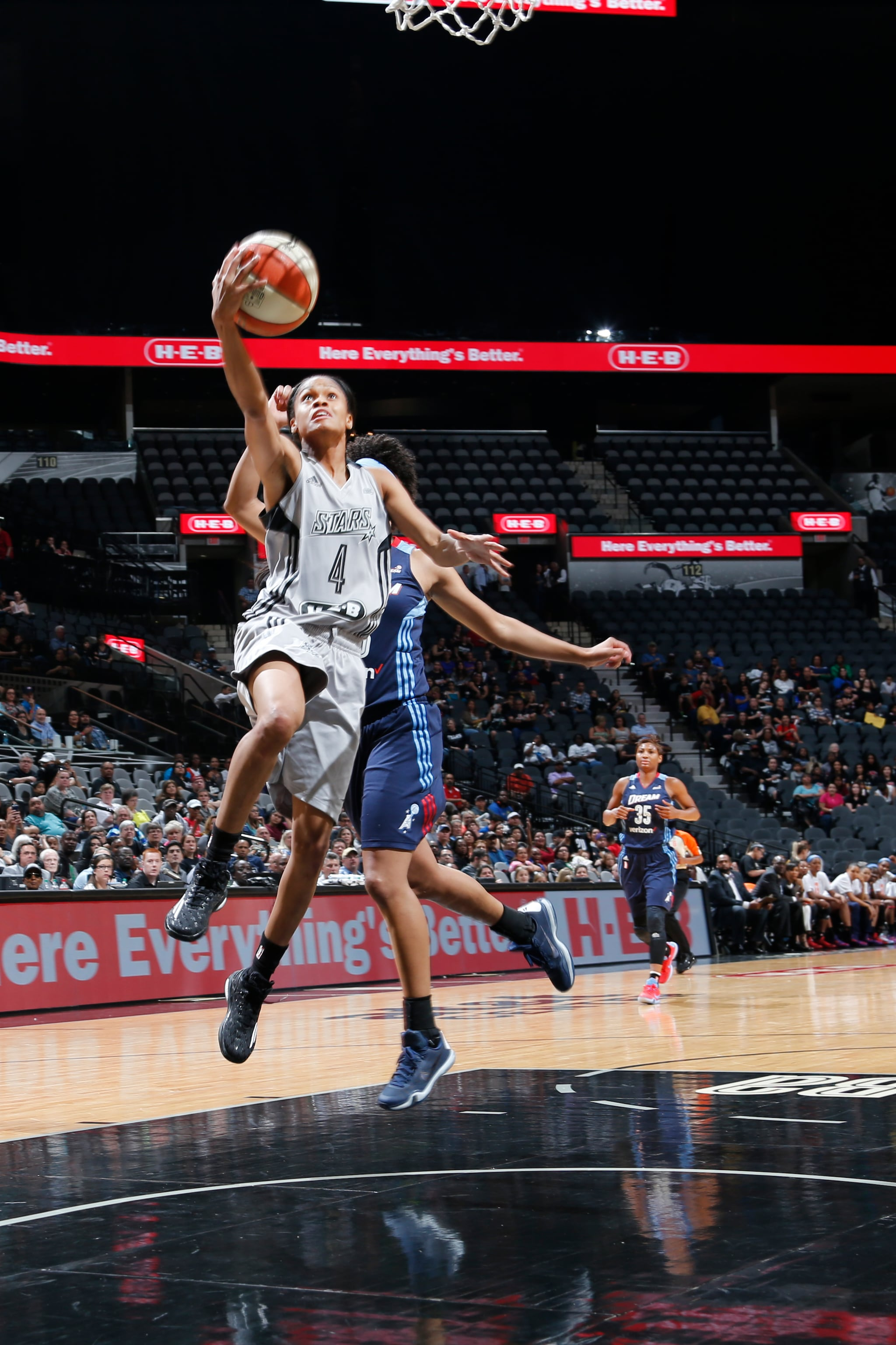 SAN ANTONIO, TX - MAY 14: Moriah Jefferson #4 of the San Antonio Stars goes for the lay up against the Atlanta Dream during the game on May 14, 2016 at AT&T Center in San Antonio, Texas. NOTE TO USER: User expressly acknowledges and agrees that, by downloading and or using this Photograph, user is consenting to the terms and conditions of the Getty Images License Agreement. Mandatory Copyright Notice: Copyright 2016 NBAE (Photo by Chris Covatta/NBAE via Getty Images)