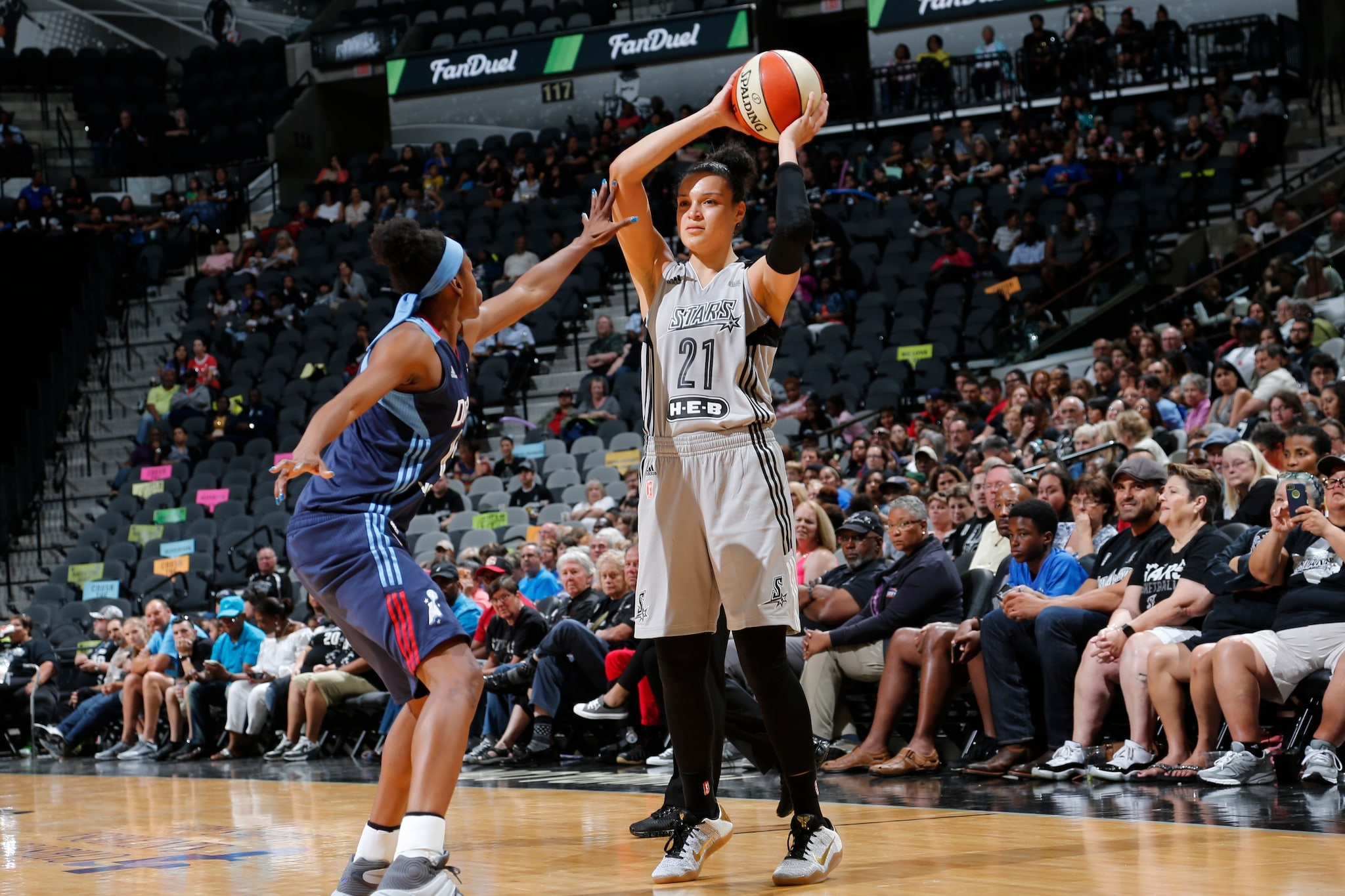 SAN ANTONIO, TX - MAY 14: Kayla McBride #21 of the San Antonio Stars defends the ball against the Atlanta Dream during the game on May 14, 2016 at AT&T Center in San Antonio, Texas. NOTE TO USER: User expressly acknowledges and agrees that, by downloading and or using this Photograph, user is consenting to the terms and conditions of the Getty Images License Agreement. Mandatory Copyright Notice: Copyright 2016 NBAE (Photo by Chris Covatta/NBAE via Getty Images)