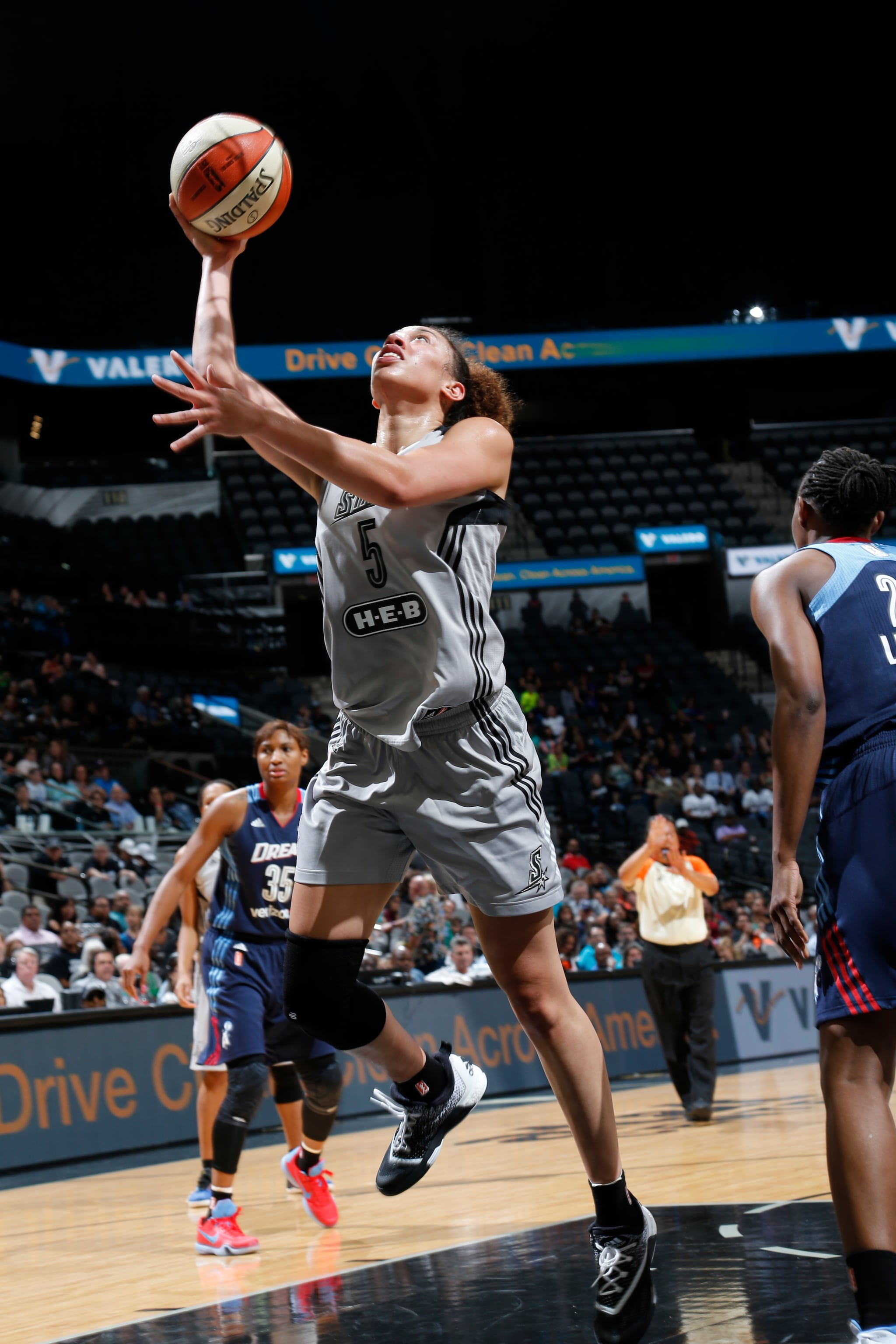 SAN ANTONIO, TX - MAY 14: Dearica Hamby #5 of the San Antonio Stars goes for the lay up against the Atlanta Dream during the game on May 14, 2016 at AT&T Center in San Antonio, Texas. NOTE TO USER: User expressly acknowledges and agrees that, by downloading and or using this Photograph, user is consenting to the terms and conditions of the Getty Images License Agreement. Mandatory Copyright Notice: Copyright 2016 NBAE (Photo by Chris Covatta/NBAE via Getty Images)