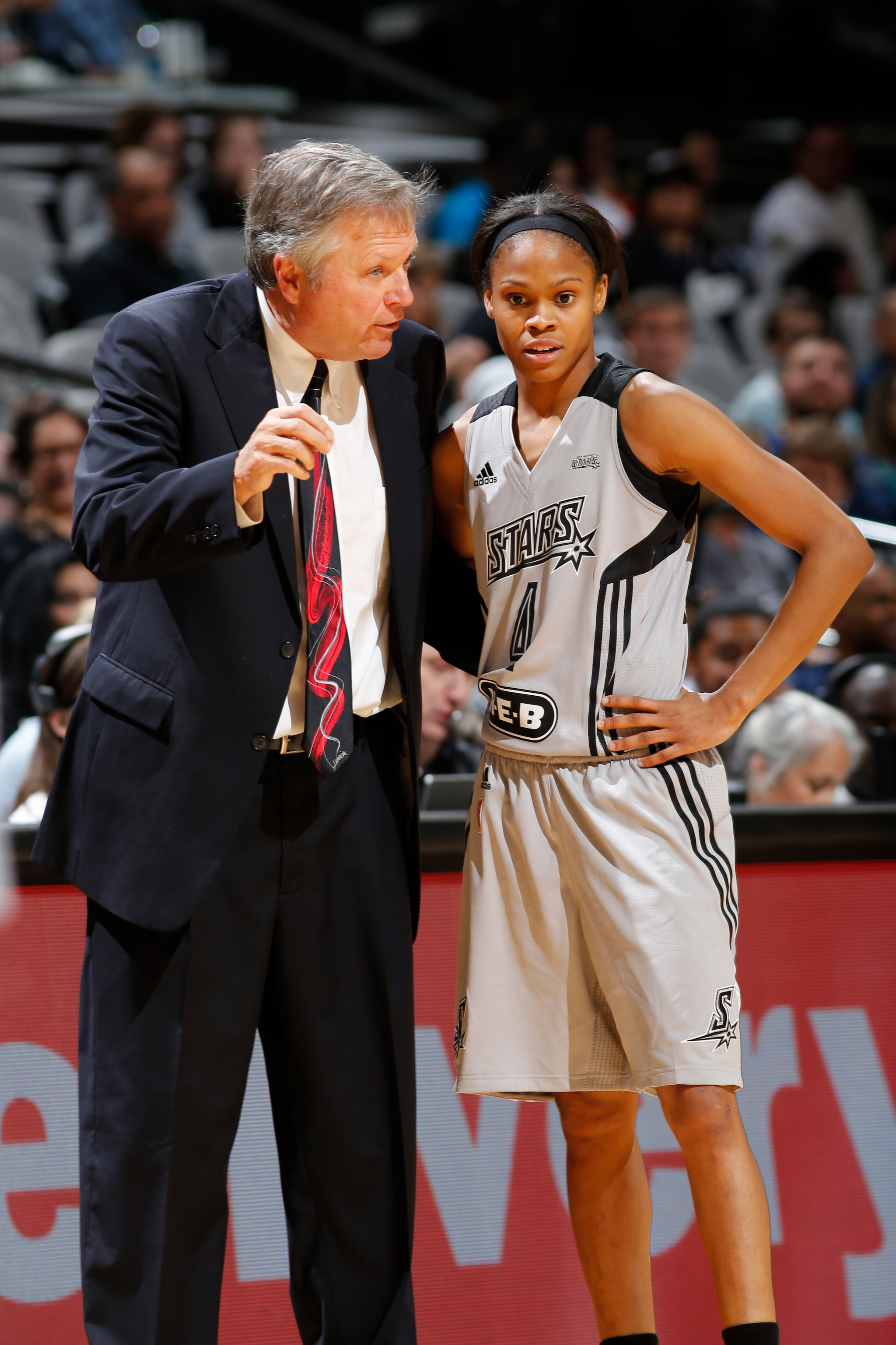 SAN ANTONIO, TX - MAY 14: Moriah Jefferson #4 of the San Antonio Stars and head coach, Dan Hughes during the game against the .at on May 14, 2016 at AT&T Center in San Antonio, Texas. NOTE TO USER: User expressly acknowledges and agrees that, by downloading and or using this Photograph, user is consenting to the terms and conditions of the Getty Images License Agreement. Mandatory Copyright Notice: Copyright 2016 NBAE (Photo by Chris Covatta/NBAE via Getty Images)