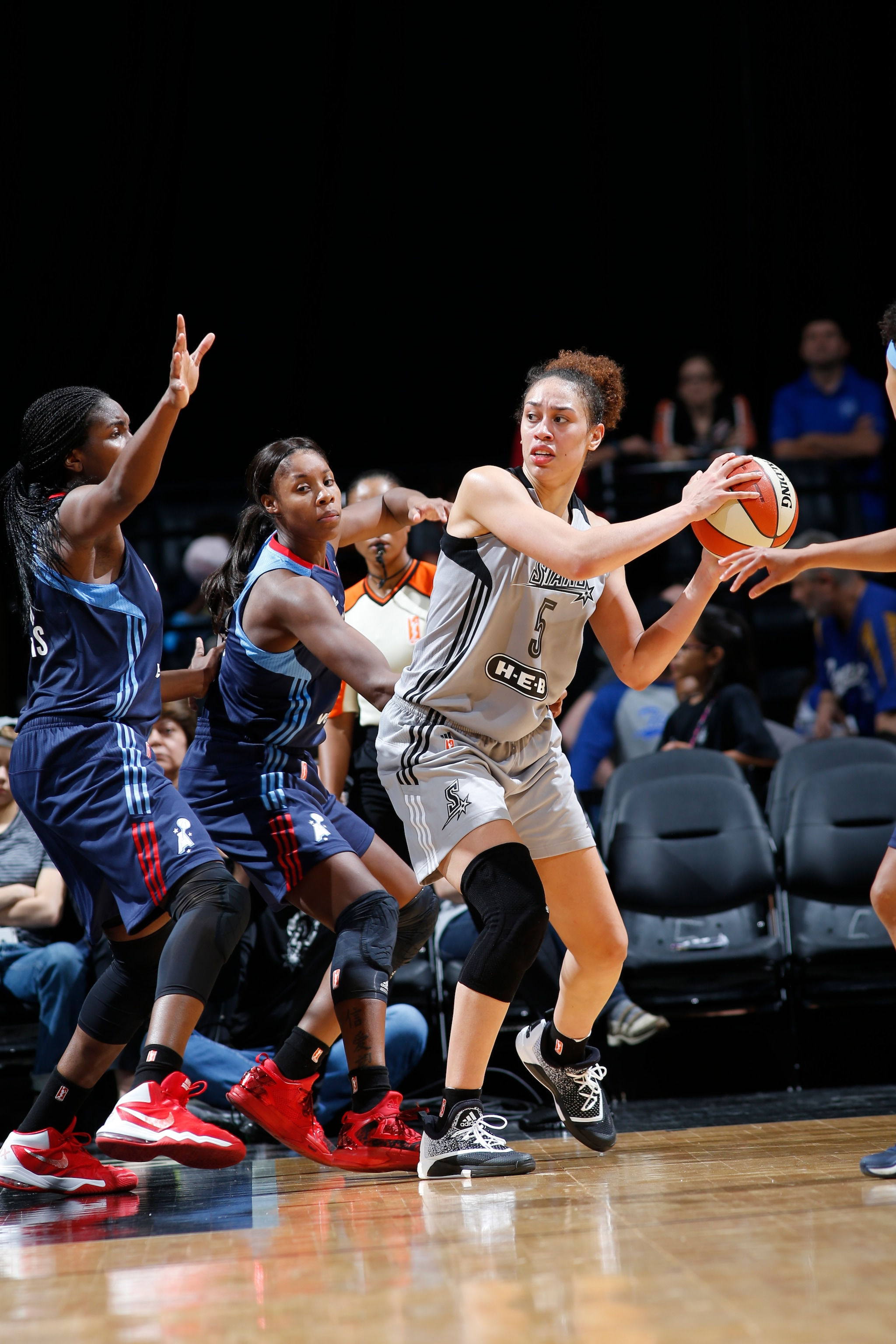 SAN ANTONIO, TX - MAY 14: Dearica Hamby #5 of the San Antonio Stars defends the ball against the Atlanta Dream during the game on May 14, 2016 at AT&T Center in San Antonio, Texas. NOTE TO USER: User expressly acknowledges and agrees that, by downloading and or using this Photograph, user is consenting to the terms and conditions of the Getty Images License Agreement. Mandatory Copyright Notice: Copyright 2016 NBAE (Photo by Chris Covatta/NBAE via Getty Images)