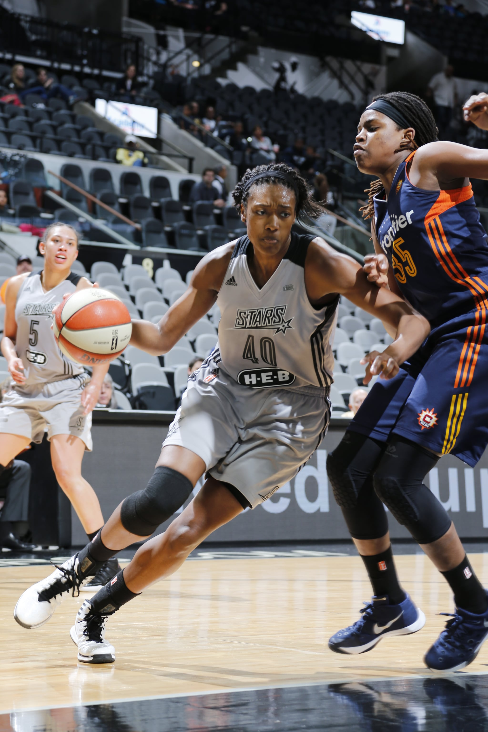 SAN ANTONIO, TX - MAY 19: Kayla Alexander #40 of the San Antonio Stars drives to the basket against the Connecticut Sun on May 19, 2016 at AT&T Center in San Antonio, Texas. NOTE TO USER: User expressly acknowledges and agrees that, by downloading and or using this Photograph, user is consenting to the terms and conditions of the Getty Images License Agreement. Mandatory Copyright Notice: Copyright 2016 NBAE (Photo by Chris Covatta/NBAE via Getty Images)