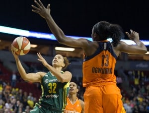 Alysha Clark shoots around the Sun's Chiney Ogwumike. (Neil Enns/Storm Photos)