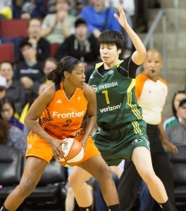 Ramu Tokashiki applies defensive pressure to the Sun's Camille Little. (Neil Enns/Storm Photos)