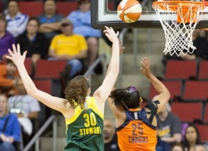 Breanna Stewart blocks a shot by the Sun's Alyssa Thomas. Stewart had three blocks on the night. (Neil Enns/Storm Photos)
