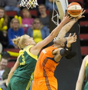 Abby Bishop applies tough defense against the Sun's Kelsey Bone. (Neil Enns/Storm Photos)