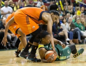 Jewell Loyd protects a loose ball late in the game. (Neil Enns/Storm Photos)