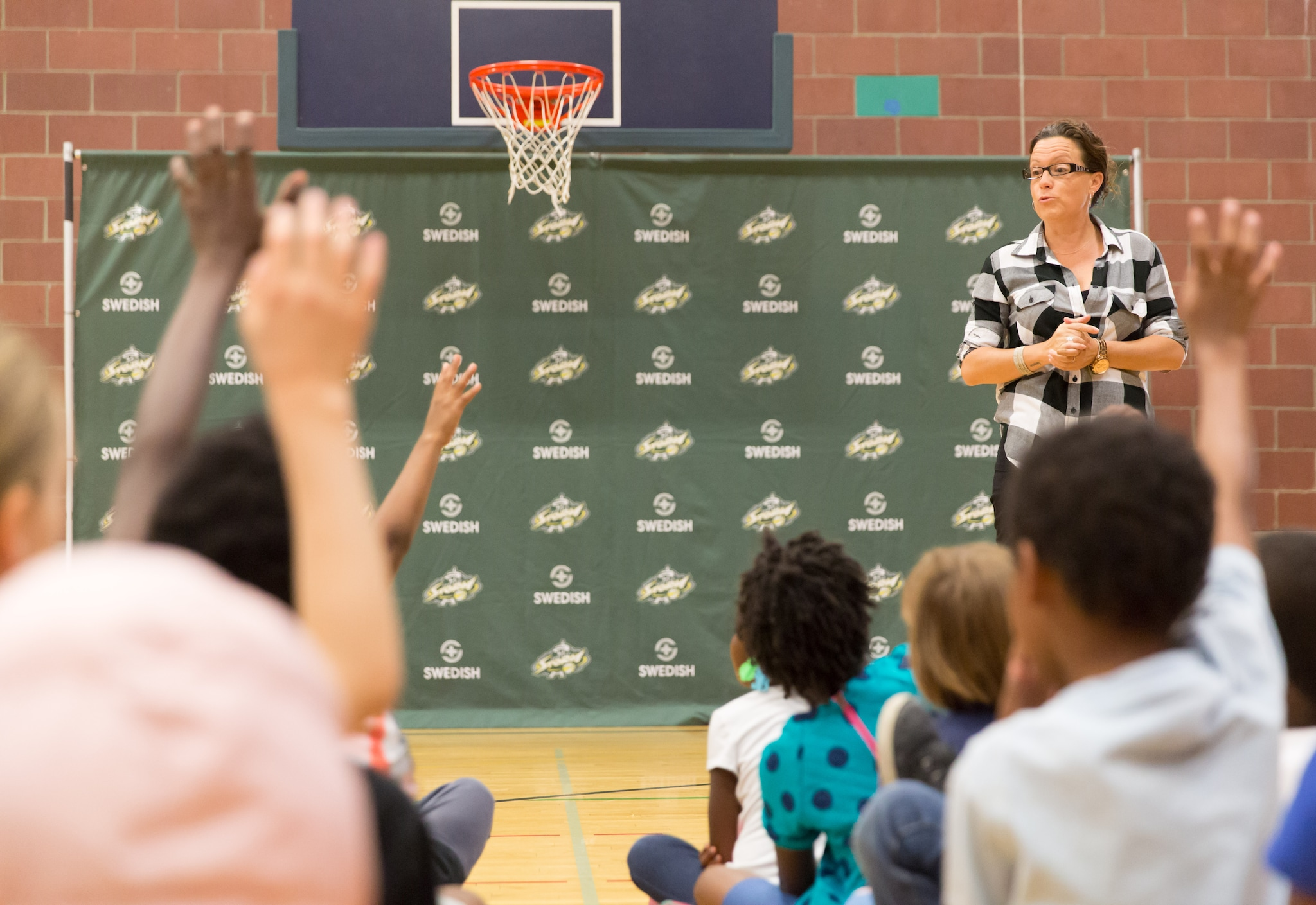Storm President and General Manager Alicia Valavanis asks how many of the kids know how to dunk. (Neil Enns/Storm Photos)