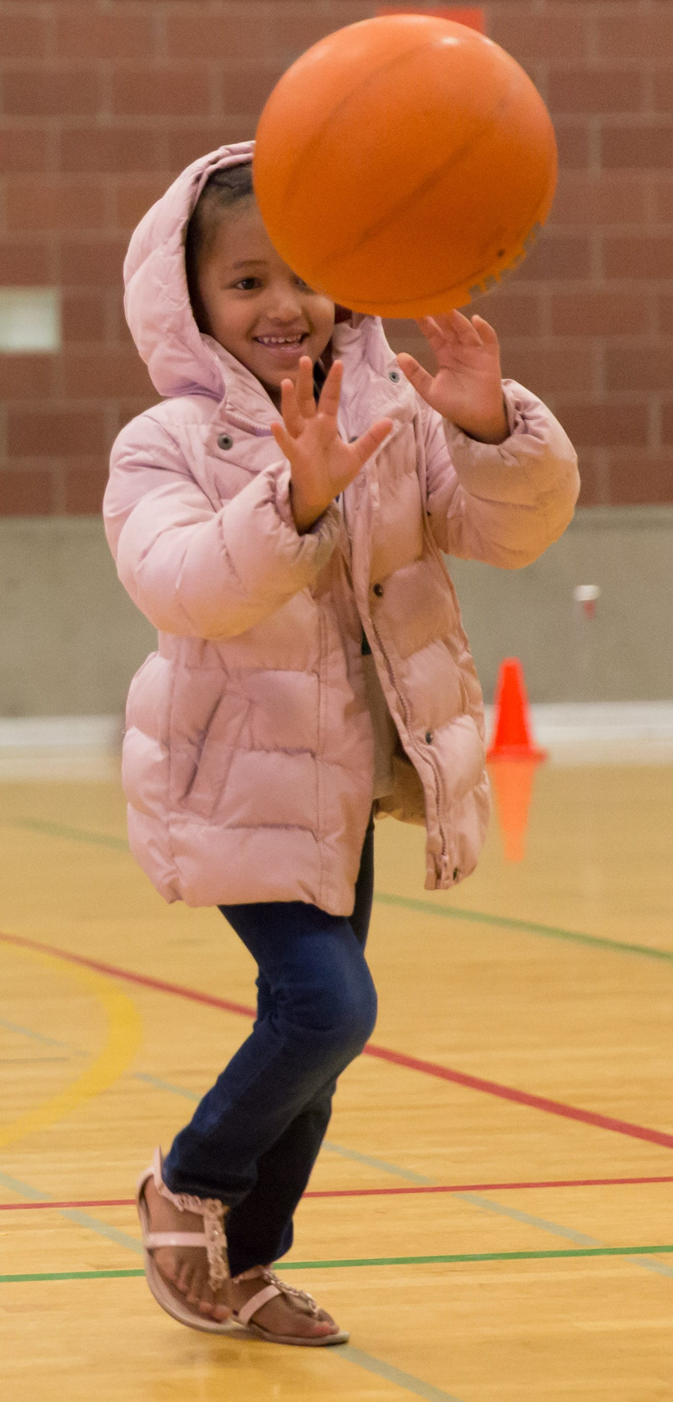 A young player races back to her team during a skills drill. (Neil Enns/Storm Photos)