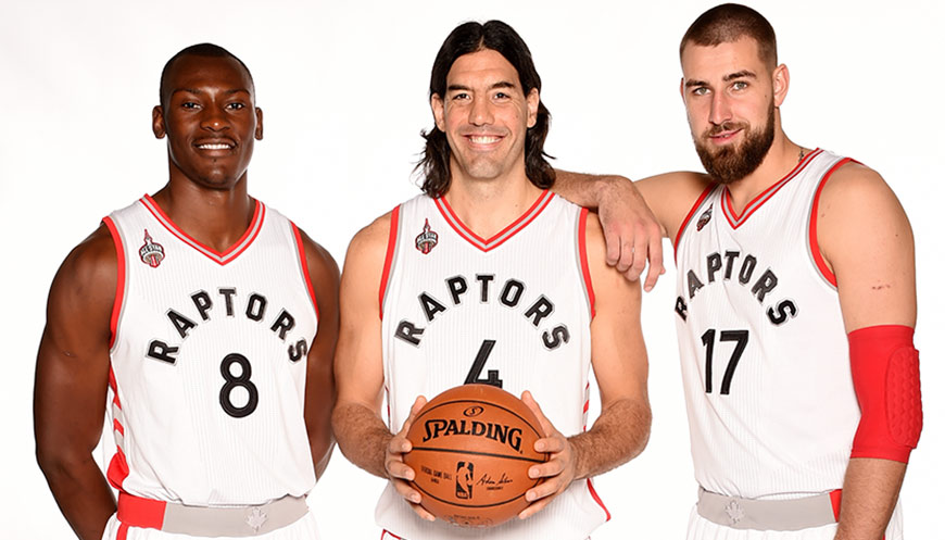 The Raptors have an NBA-high seven international players, including (from left) Bismack Biyombo, Luis Scola and Jonas Valanciunas. (Ron Turenne/NBAE via Getty Images)