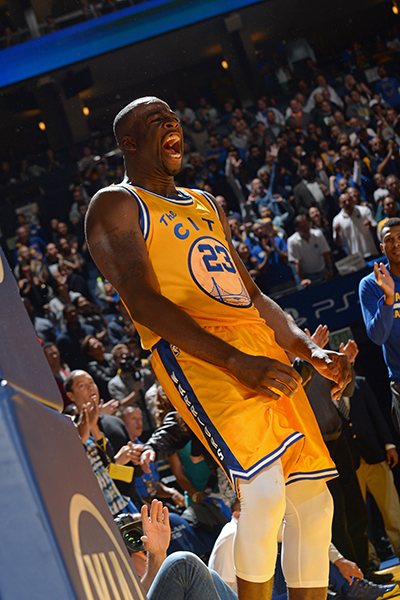 OAKLAND, CA - NOVEMBER 17: Draymond Green #23 of the Golden State Warriors celebrates a play against the Toronto Raptors on November 17, 2015 at Oracle Arena in Oakland, California. NOTE TO USER: User expressly acknowledges and agrees that, by downloading and or using this photograph, user is consenting to the terms and conditions of Getty Images License Agreement. Mandatory Copyright Notice: Copyright 2015 NBAE (Photo by Noah Graham/NBAE via Getty Images)