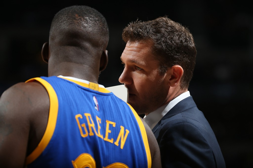 DENVER, CO - NOVEMBER 22: Interim head coach Luke Walton of the Golden State Warriors talks to Draymond Green #23 of the Golden State Warriors as they face the Denver Nuggets at Pepsi Center on November 22, 2015 in Denver, Colorado. The Warriors defeated the Nuggets 118-105 to start the season 15-0. NOTE TO USER: User expressly acknowledges and agrees that, by downloading and or using this photograph, User is consenting to the terms and conditions of the Getty Images License Agreement. (Photo by Doug Pensinger/Getty Images)