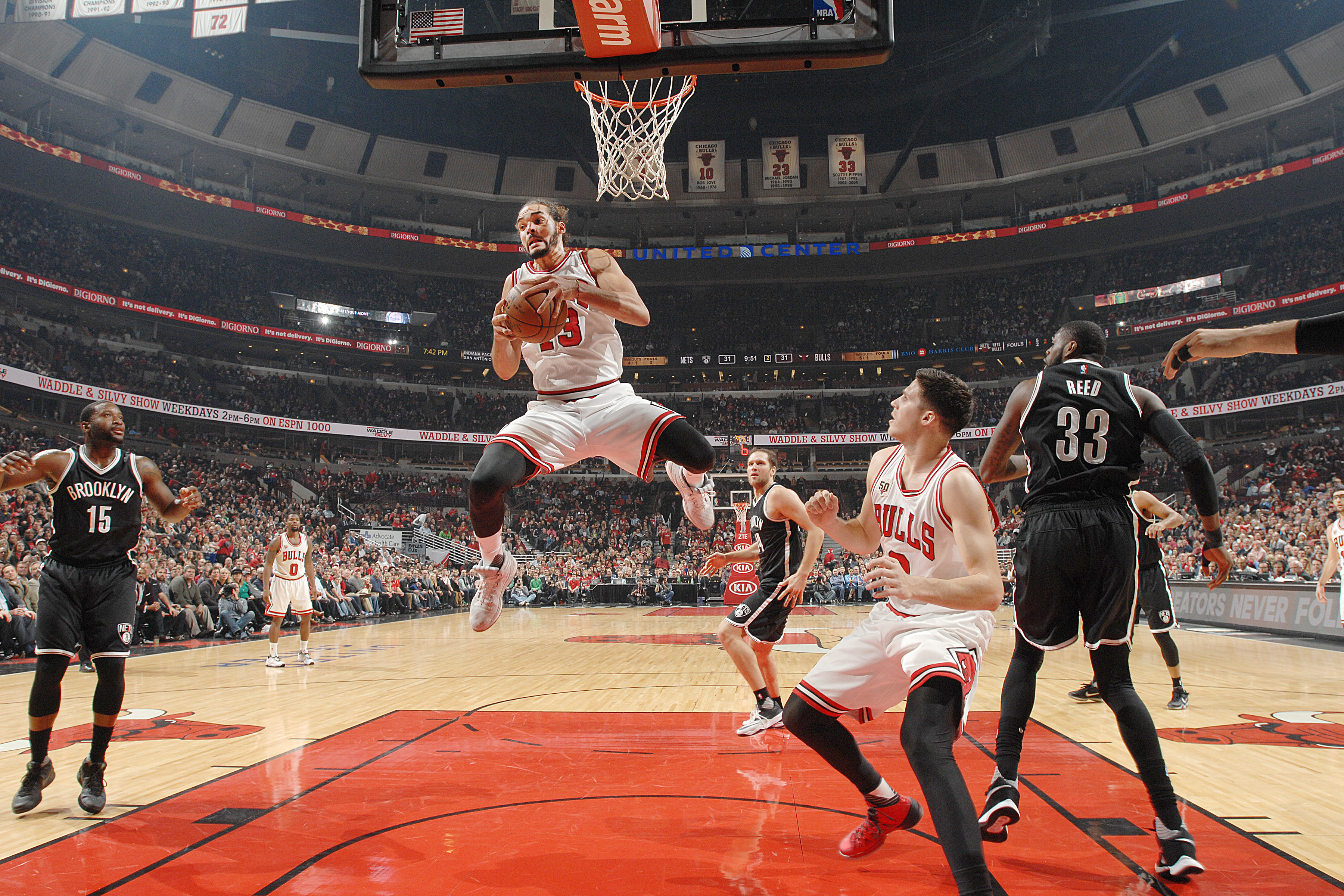 CHICAGO, IL - DECEMBER 21: Joakim Noah #13 of the Chicago Bulls grabs the rebound against the Brooklyn Nets on December 21, 2015 at the United Center in Chicago, Illinois. NOTE TO USER: User expressly acknowledges and agrees that, by downloading and or using this photograph, user is consenting to the terms and conditions of the Getty Images License Agreement. Mandatory Copyright Notice: Copyright 2015 NBAE (Photo by Randy Belice/NBAE via Getty Images)