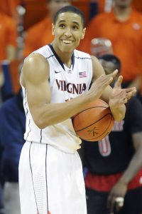 CHARLOTTESVILLE, VA - FEBRUARY 07: Malcolm Brogdon #15 of the Virginia Cavaliers celebrates a win after a college basketball game against the Louisville Cardinals at the John Paul Jones Arena on February 7, 2015 in Charlottesville, Virginia. The Cavaliers won 52-47. (Photo by Mitchell Layton/Getty Images)